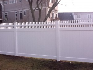 tongue and groove vinyl fence with decorative topper....